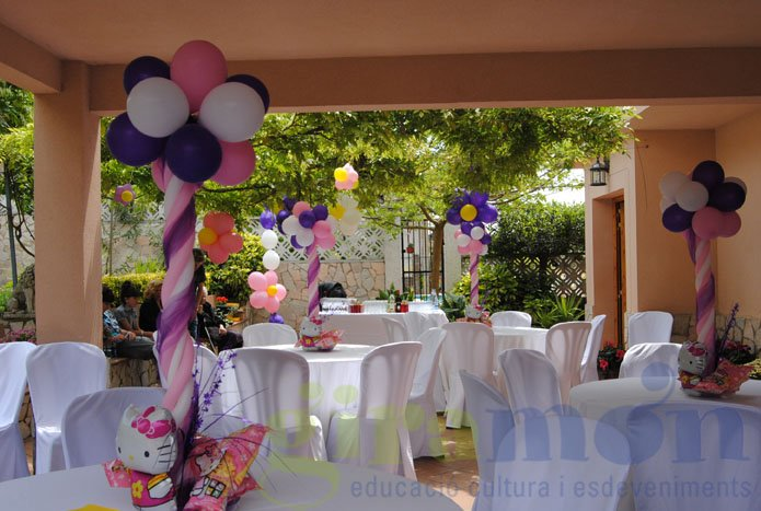 Centros de mesa para comuniones giram n giram n - Como decorar un salon para comunion ...